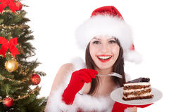 Christmas girl in  santa hat and cake on plate. Royalty Free Stock Photo