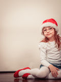 Christmas girl in santa hat festive outfit Stock Image