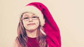 Christmas girl in santa hat festive outfit royalty free stock image