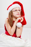 Christmas girl in santa hat festive outfit Stock Photos