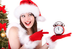 Christmas girl in santa hat and fir tree,  clock. Royalty Free Stock Photo