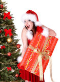 Christmas girl in santa hat and fir tree, gift box Stock Image