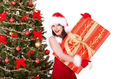 Christmas girl in santa hat,  fir tree,  gift box Royalty Free Stock Photography