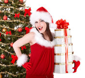 Christmas girl in santa hat,  fir tree,  gift box. Royalty Free Stock Photos