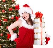 Christmas girl in santa hat,  fir tree,  gift box. Royalty Free Stock Photos