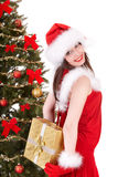 Christmas girl in santa hat, fir tree, gift box. Stock Photography