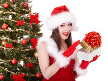 Christmas girl in santa hat, fir tree, gift box. Stock Photography