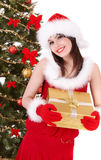 Christmas girl in santa hat and fir tree, gift box Royalty Free Stock Images