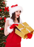 Christmas girl in santa hat with gold gift box Royalty Free Stock Photos