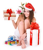 Christmas girl in santa hat, group gift box in spa royalty free stock photography
