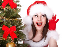Christmas girl in santa hat, hand near ear, listen Royalty Free Stock Photos