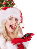 Christmas girl in santa hat holding auto keys. Royalty Free Stock Photography