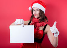 Christmas girl in santa hat holding banner. Stock Photo