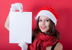 Christmas girl in santa hat holding banner. Royalty Free Stock Photography