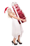 Christmas girl in santa hat holding  gift box. Royalty Free Stock Images