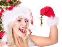 Christmas girl in santa hat holding house keys. Stock Image
