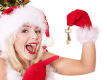 Christmas girl in santa hat holding house keys. Royalty Free Stock Image