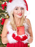 Christmas girl in santa hat holding red gift box. Stock Image