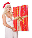 Christmas girl in santa hat holding red gift box. Stock Photo