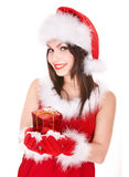 Christmas girl in santa hat holding red gift box. Stock Photography
