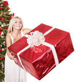 Christmas girl in santa hat holding red gift box. Royalty Free Stock Photography