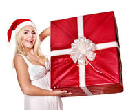 Christmas girl in santa hat holding red gift box. Royalty Free Stock Photos