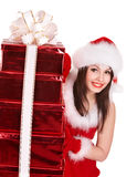 Christmas girl in santa hat holding stack gift box. Christmas girl in santa hat holding stack red gift box. Isolated Royalty Free Stock Photography