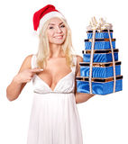 Christmas girl in santa hat holding stack gift box. Christmas girl in santa hat holding stack red gift box. Isolated Royalty Free Stock Image