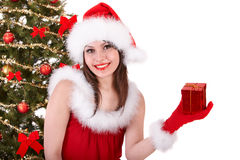 Christmas girl in santa hat with small gift box. Stock Photo