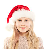 Christmas Girl in Santa Hat Smiling on White Royalty Free Stock Images