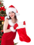 Christmas girl in santa hat, sock, tree. Royalty Free Stock Image