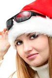 Christmas girl  in santa hat and sun glasses Stock Photography