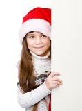 Christmas girl in santa helper hat with blank white board. isola Royalty Free Stock Photography