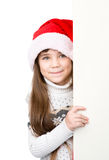 Christmas girl in santa helper hat with blank white board. isolated Royalty Free Stock Image
