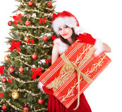 Christmas girl in santa holding gift box. Royalty Free Stock Photography