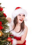 Christmas girl in santa holding gift box. Royalty Free Stock Photo