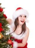 Christmas girl in santa holding gift box. Royalty Free Stock Photo