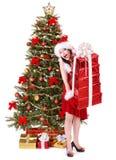 Christmas girl in santa holding stack gift box. Royalty Free Stock Image