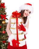 Christmas girl in santa holding stack gift box. Stock Images