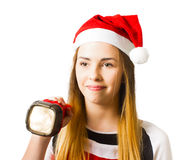 Christmas girl on a search and find present hunt Stock Photo