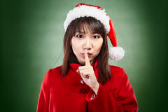 Christmas girl shhing Royalty Free Stock Photography
