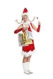 Christmas girl shopping. Pretty young girl in santa outfit having fun while shopping Stock Photo
