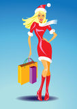 Christmas girl with shopping bags Stock Images
