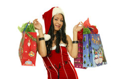 Christmas girl with shopping bags. Christmas shopping bags held by santa royalty free stock photos