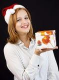 Christmas girl with shopping bags Stock Photos