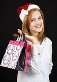 Christmas girl with shopping bags Stock Photography
