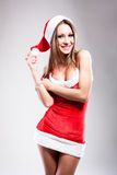 Christmas girl in short and sexy costume Stock Photography