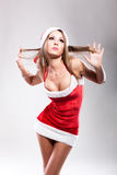 Christmas girl in short and sexy costume Stock Photos