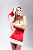 Christmas girl in short and sexy costume Royalty Free Stock Photography