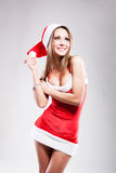 Christmas girl in short and sexy costume Stock Images